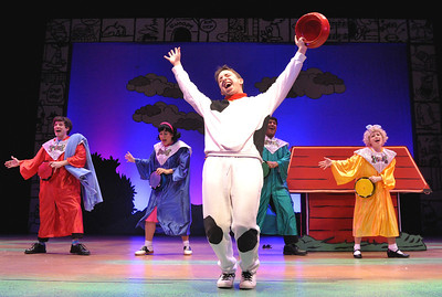 "Snoopy (James Gardiner) and the Peanuts gang praise the glorious thing that is ""Suppertime"" in Olney Theatre Center's production of YOU'RE A GOOD MAN, CHARLIE BROWN.  (Photo: Stan Barouh)"