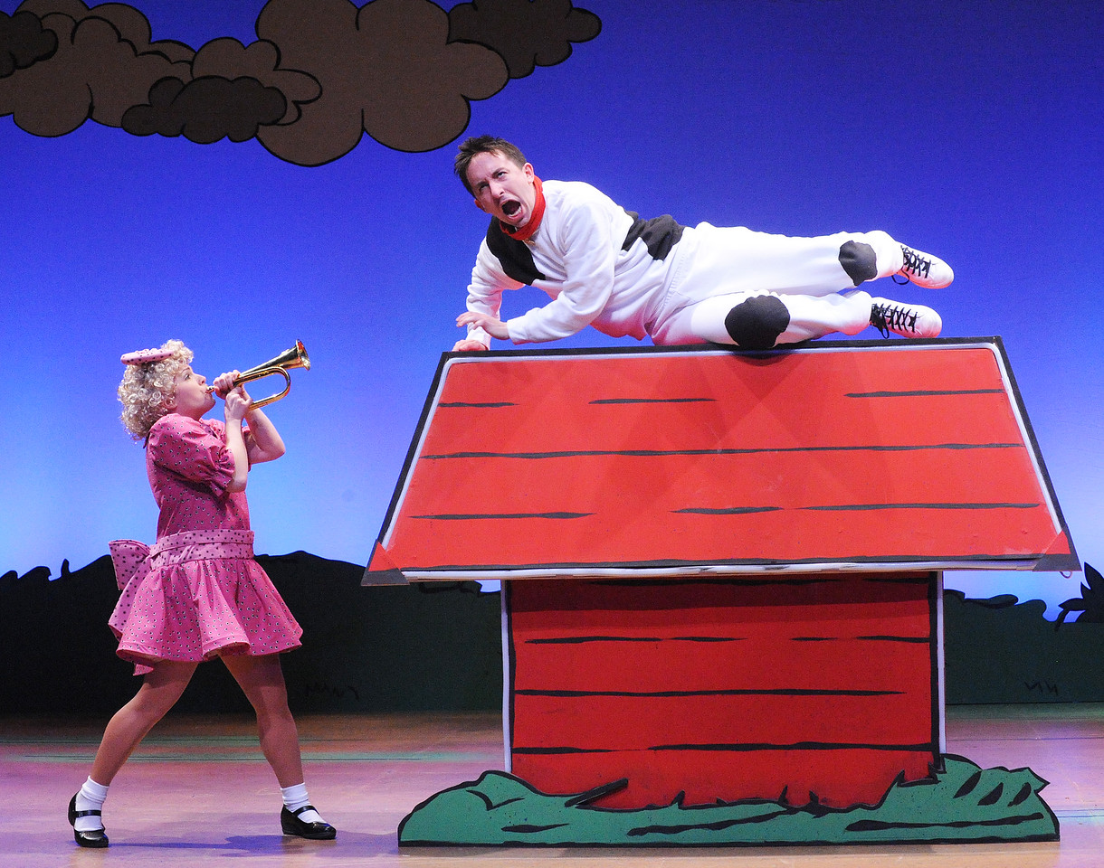 Blow that bugle at that Beagle, Sally Brown! Sally (Jaimie Kelton) gives Snoopy (James Gardiner) a rude awakening in Olney Theatre Center's production of YOU'RE A GOOD MAN, CHARLIE BROWN.  (Photo: Stan Barouh)