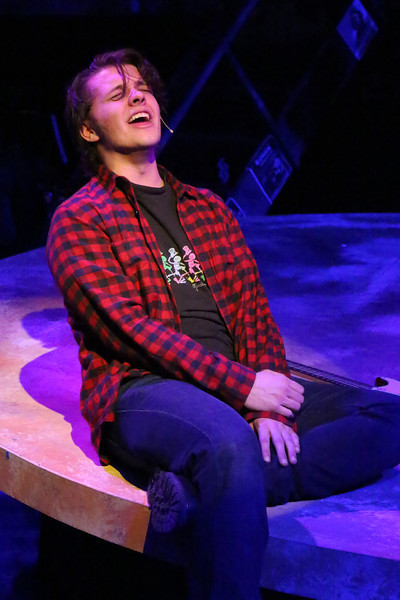 "Evan Fornachon as Roger, singing ""One Song Glory,"" in New Line Theatre's ""RENT,"" 2014. Photo credit: Jill Ritter Lindberg."