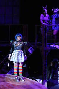 """Sarah Porter as Maureen in """"Over the Moon,"""" with her back-up singers Marcy Wiegert and Wendy Greenwood, in New Line Theatre's """"RENT,"""" 2014. Photo credit: Jill Ritter Lindberg."""