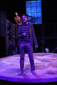 """Jeremy Hyatt (as Mark, foreground) and Evan Fornachon (as Roger, in the background), singing """"What You Own,"""" in New Line Theatre's """"RENT,"""" 2014. Photo credit: Jill Ritter Lindberg."""