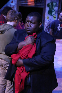 """Marshall Jennings (as Collins) singing the reprise of """"I'll Cover You,"""" in New Line Theatre's """"RENT,"""" 2014. Photo credit: Jill Ritter Lindberg."""