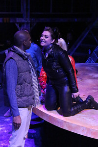 """Shawn Bowers (as Benny, left) and Sarah Porter (as Maureen) in New Line Theatre's """"RENT,"""" 2014. Photo credit: Jill Ritter Lindberg."""