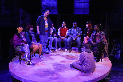 """Zachary Allen Farmer (standing) and the cast, singing """"Life Support,"""" in New Line Theatre's """"RENT,"""" 2014. Photo credit: Jill Ritter Lindberg."""