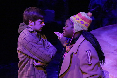 """Jeremy Hyatt (Mark) being confronted by Melissa Harris (as an angry homeless woman), in """"On the Street,"""" in New Line Theatre's """"RENT,"""" 2014. Photo credit: Jill Ritter Lindberg."""