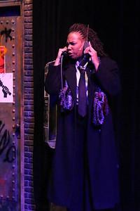 "Cody LaShea (Joanne), singing ""We're Okay,"" in New Line Theatre's ""RENT,"" 2014. Photo credit: Jill Ritter Lindberg."