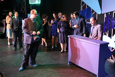 "Zachary Allen Farmer (left foreground) as J.J. Hunsecker and the cast listen as Sean Michael (far right) as Dallas sings ""One Track Mind,"" in SWEET SMELL OF SUCCESS, New Line Theatre, 2017. Photo credit: Jill Ritter Lindberg."