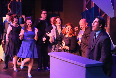 "The cast listens as William Pendergast (far right) sings ""Laughin' All the Way to the Bank"" in SWEET SMELL OF SUCCESS, New Line Theatre, 2017. Photo credit: Jill Ritter Lindberg."