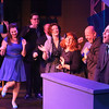 """The cast listens as William Pendergast (far right) sings """"Laughin' All the Way to the Bank"""" in SWEET SMELL OF SUCCESS, New Line Theatre, 2017. Photo credit: Jill Ritter Lindberg."""