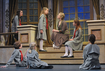 Maria (Jessica Lauren Ball) talks with the von Trapp children in Olney Theatre Center's production of THE SOUND OF MUSIC. (Photo Credit: Stan Barouh)