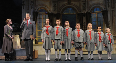 Maria (Jessica Lauren Ball) meets Captain Georg von Trapp (George Dvorsky) and the von Trapp children in Olney Theatre Center's production of THE SOUND OF MUSIC. (Photo Credit: Stan Barouh)