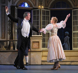 Captain Georg von Trapp (George Dvorsky) and Maria (Jessica Lauren Ball) dance the Lindler, an Austrian folk dance, in Olney Theatre Center's production of THE SOUND OF MUSIC. (Photo Credit: Stan Barouh)