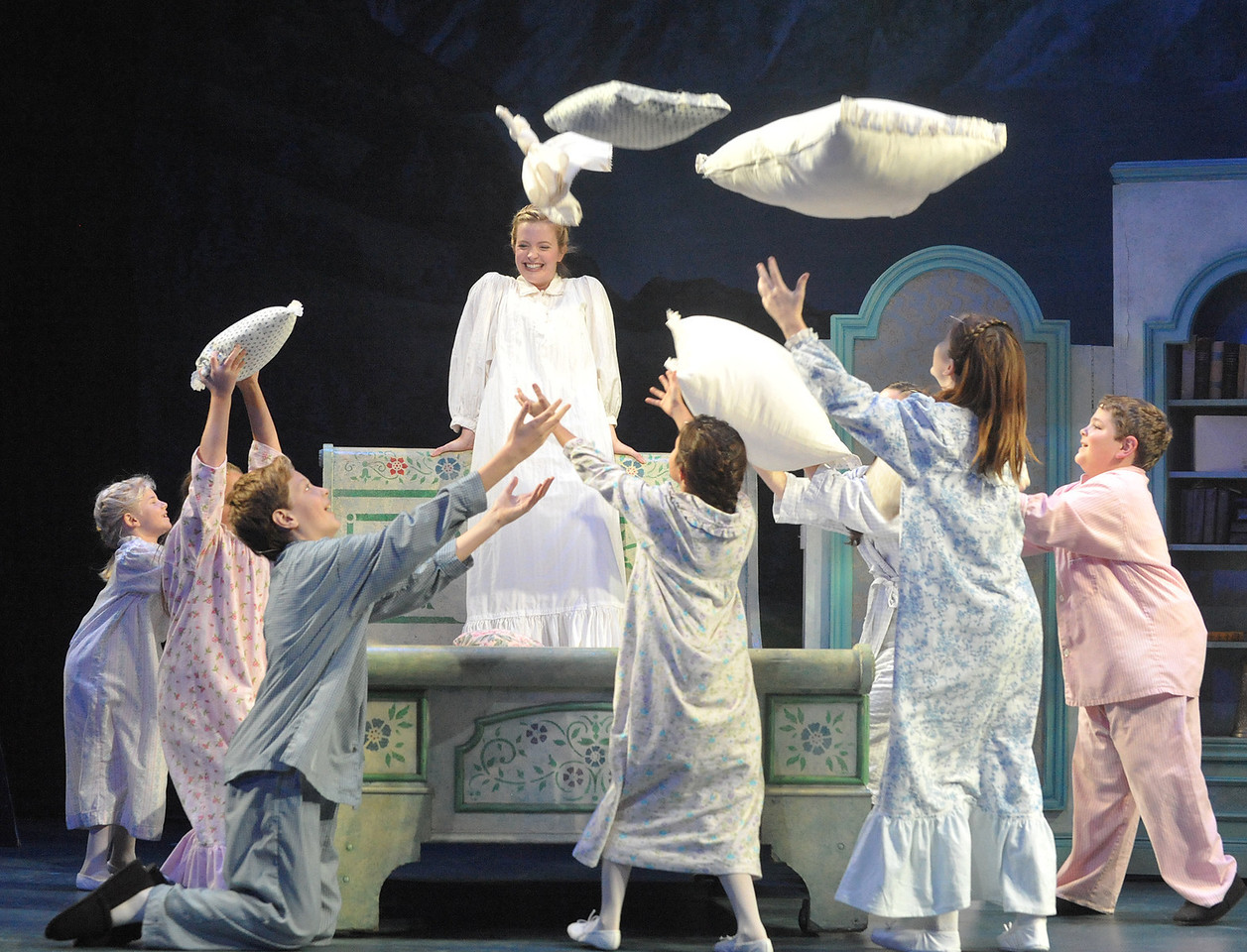 Maria (Jessica Lauren Ball) and the von Trapp children chase their fears away with a song in Olney Theatre Center's production of THE SOUND OF MUSIC. (Photo Credit: Stan Barouh)