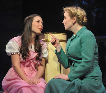 Liesl (Maggie Donovan) and Maria (Jessica Lauren Ball) share a moment in Olney Theatre Center's production of THE SOUND OF MUSIC. (Photo Credit: Stan Barouh)