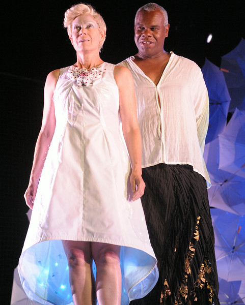 Julie-Ann Elliott (as Ariel) and Craig Wallace (as Prospero) in Olney Theatre Center's production of THE TEMPEST. (Photo: Stan Barouh)