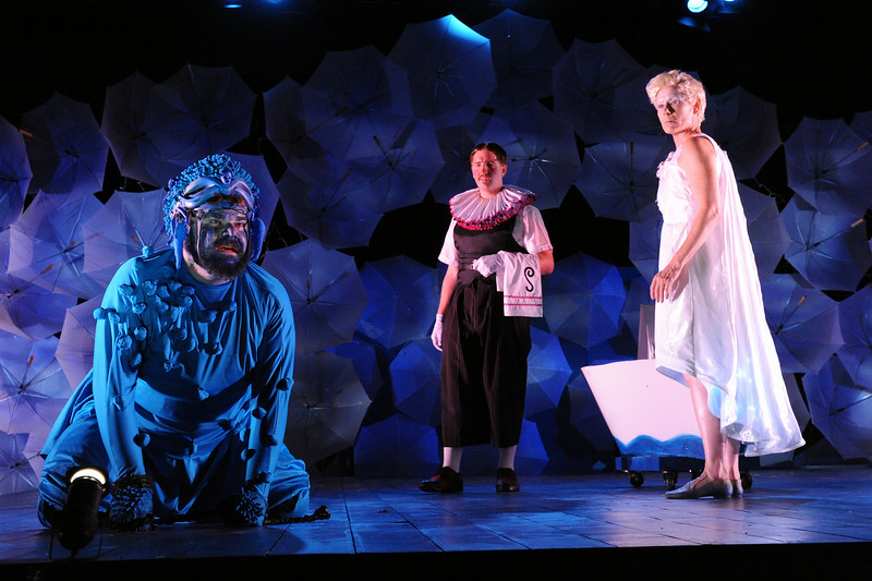 Caliban (Ryan Mitchell) recalls how Prospero has treated him as Stephano (Dan Van Why) and Ariel (Julie-Ann Elliott) look on in Olney Theatre Center's production of THE TEMPEST. (Photo: Stan Barouh)