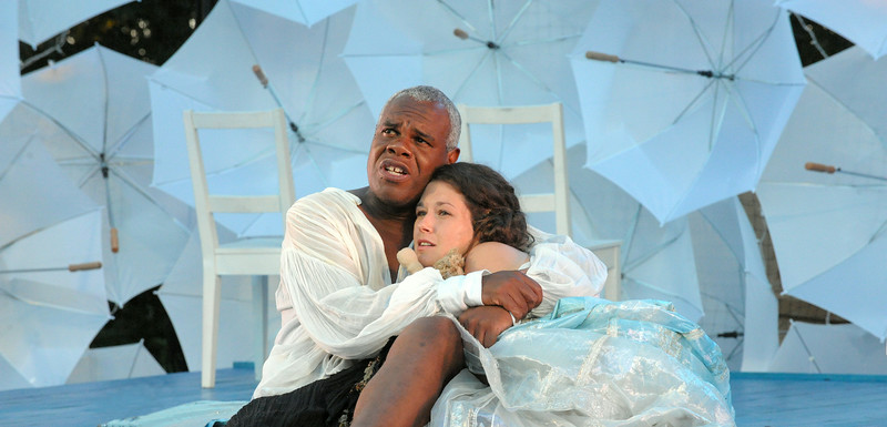 Prospero (Craig Wallace) tells his daughter Miranda (Leah Filley) the tale of how they ended up on this magical island in Olney Theatre Center's production of THE TEMPEST. (Photo: Stan Barouh)