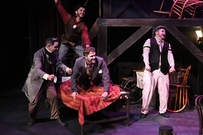 "Mack's gang -- (l-r) Readymoney Matt (Brian Claussen), Walt Dreary (Todd Micali, in back), Bob the Saw (Luke Steingruby), and Crookfinger Jake (Kent Coffel), singing the ""Wedding Song,"" in New Line Theatre's THREEPENNY OPERA, 2015. Photo credit: Jill Ritter Lindberg."