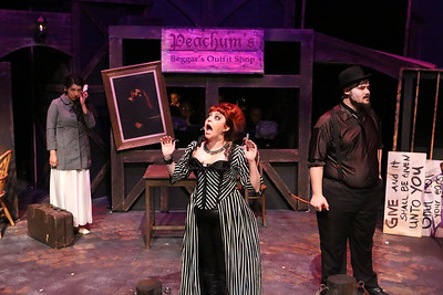 (l-r) Polly Peachum (Cherlynn Alvarez) tells  Mrs. Peachum (Sarah Porter), and Mr. Peachum (Zachary Allen Farmer) that she's gotten married, in New Line Theatre's THREEPENNY OPERA, 2015. Photo credit: Jill Ritter Lindberg.