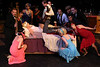 The cast of New Line Theatre's THE WILD PARTY, with Jeffrey Pruett as Burrs and Margeau Baue Steinau as Queenie, on the bed. Photo credit: Jill Ritter.