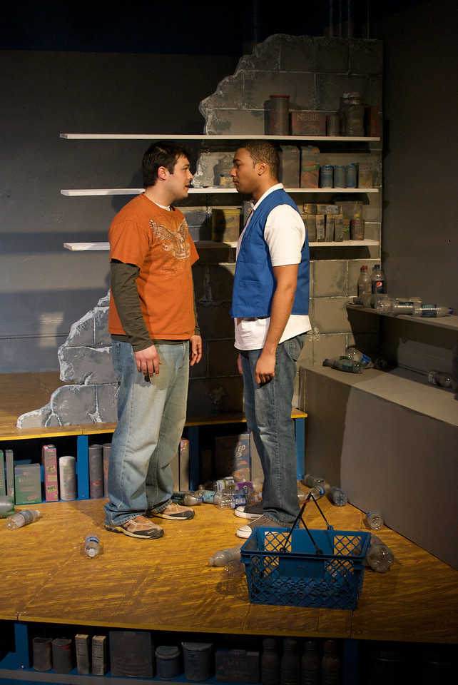 Derek Garza (Ebenn) and Sentell Harper (Tommy) in Mortar Theatre Company's I AM MONTANA  <br /> <br /> April 7 - May 1, 2011  <br /> <br /> Director: Rachel Edwards Harvith <br /> Scenic & Costume Design: Robert S. Kuhn <br /> Lighting Design: Justin Wardell