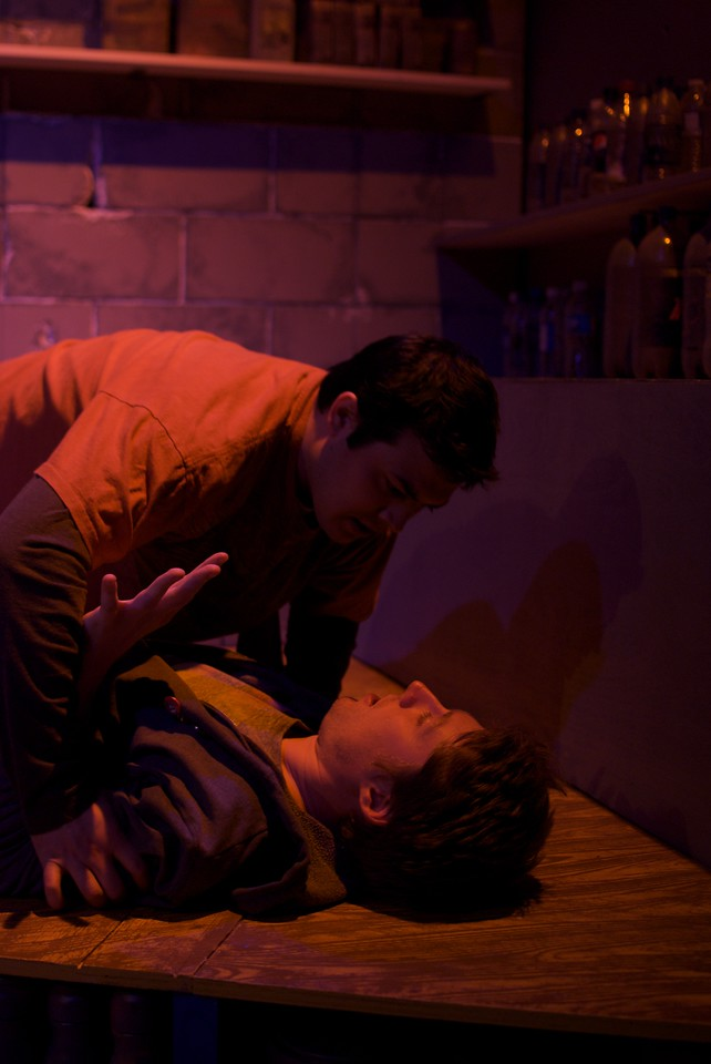 Derek Garza (Ebenn) and Josh Nordmark (Dirk) in Mortar Theatre Company's I AM MONTANA  <br /> <br /> April 7 - May 1, 2011  <br /> <br /> Director: Rachel Edwards Harvith <br /> Scenic & Costume Design: Robert S. Kuhn <br /> Lighting Design: Justin Wardell