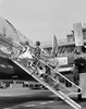 846-05645886<br /> © ClassicStock / Masterfile<br /> Model Release: Yes<br /> Property Release: No<br /> 1950s FAMILY FATHER MOTHER DAUGHTER SON BOARDING PROPELLER AIRLINER BY CLIMBING GANGWAY STAIRS AT AIRPORT