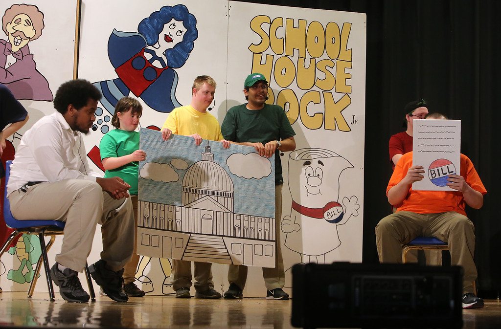 """. From left, Marcus Mengistab of Billerica, Mary Alice Jackson and Jack Saba of Chelmsford, Arun Maudgal of Westford, and Justin Goyette of Tyngsboro (holding sign), perform \""""Just a Bill.\"""" Valley Collaborative Transitional High School students perform School House Rock Live! Jr. musical. (SUN/Julia Malakie)"""