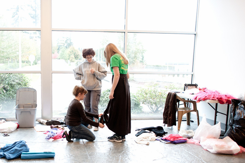 Costume Designer Debbie Sorensen and Costume Manager Jennifer Stewart begin the process of fitting costumes to cast members.