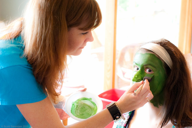 Hair and Makeup Director, Aimee Hancock works on makeup and facial appliances for the Wicked Witch of the West.