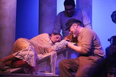 Madame Hortense (Margeau Steinau) falls ill, as Zorba (Kent Coffel) and Nikos (Dominic Windsor-Dowdy) comfort her, in ZORBA, New Line Theatre, 2017. Photo credit: Jill Ritter Lindberg.