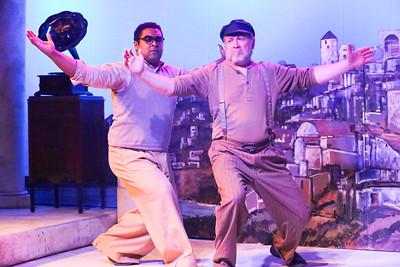 Nikos (Dominic Dowdy-Windsor) and Zorba (Kent Coffel) dance a final dance together before parting ways, in ZORBA, New Line Theatre, 2017. Photo credit: Jill Ritter Lindberg.