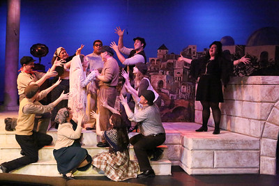 """The Leader (Lindsey Jones, far right) and the company celebrate the wedding of Zorba (Kent Coffel) and Madame Hortense (Margeau Steinau), in """"Y'assou,"""" in ZORBA, New Line Theatre, 2017. Photo credit: Jill Ritter Lindberg."""