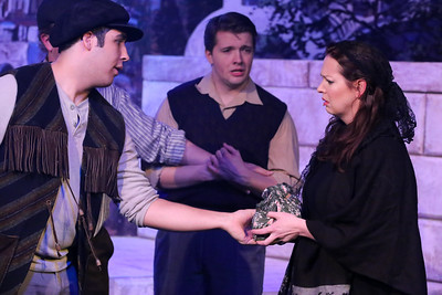 Manolakos (William Pendergast, left) confronts the Widow (Ann Hier), as the lovesick Pavli (Evan Fornachon) looks on, in ZORBA, New Line Theatre, 2017. Photo credit: Jill Ritter Lindberg.