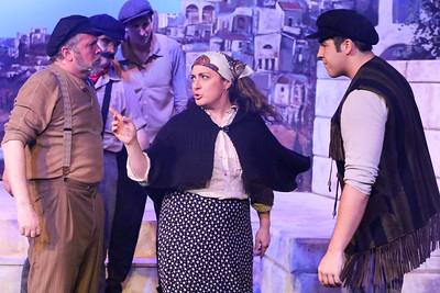 Fivos (Mara Bollini) stops a fight between Zorba (Kent Coffel) and Manolakos (William Pendergast), in ZORBA, New Line Theatre, 2017. Photo credit: Jill Ritter Lindberg.