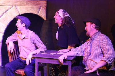 Mimiko (Devin Riley), Fivos (Mara Bollini), and Katapolis (Robert Doyle), in the cafe at Khania, in ZORBA, New Line Theatre, 2017. Photo credit: Jill Ritter Lindberg.