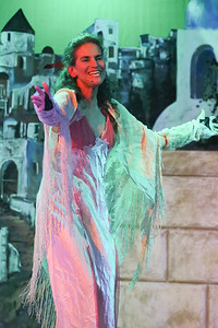 "Madame Hortense (Margeau Steinau) sings ""Happy Birthday,"" in ZORBA, New Line Theatre, 2017. Photo credit: Jill Ritter Lindberg."