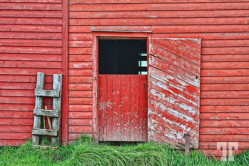 Door of a red barn in Trout River village - Gross Morne National Park