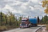 Transporting heavy industrial equipment.<br /> <br /> - We were driving in the opposite direction, but a police car came a few minutes in front of this big truck, to warn everybody to pull on the right side of the road until he passes.<br /> <br /> Sept. 23, 2010