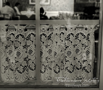 Bistro window with lace, in Quebec