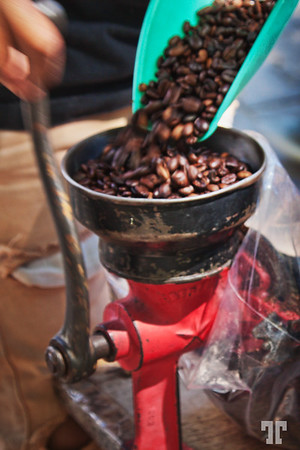Grinding coffee at Ajijic mercado, Mexico