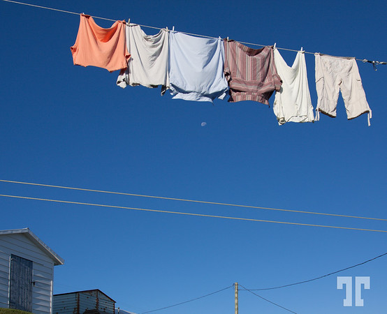 Low angle view of clothes or laundry on washing line with blue sky background.<br /> (xx)