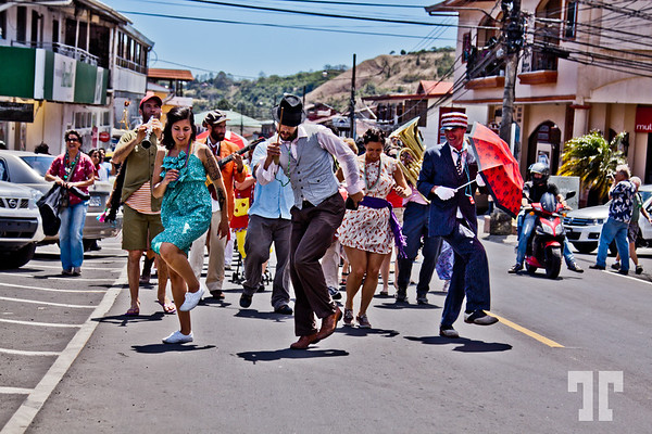 """March 3 2012<br /> <br /> Fun at the Jazz Festival in Boquete, Panama - Street Parade<br /> <br /> Thank you for all you comments yesterday, and sorry I couldn't comment early in the morning, but I'm way behind everything, including the editing of the photos and my neglected business....<br /> <br /> Yes, this is indeed a festival in the style of New Orleans music and dance (and fun) events.<br /> <br /> - The main band of musicians and dancers is from New Orleans including the 2 dancers in the foreground - which<br /> are absolutely stunning (I have many shots with them dancing) <br /> <br /> - The band is called """" Smoking Time Jazz Club"""" and the super talented lady, Giselle Anguinzola is originally from Panama."""