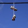 Hanaging shoes<br /> <br /> I just saw these sport shoes hanging from a power line in a small village and couldn't resist shooting them :)<br /> Nova Scotia, Canada