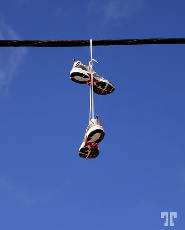 Hanaging shoes  I just saw these sport shoes hanging from a power line in a small village and couldn't resist shooting them :) Nova Scotia, Canada