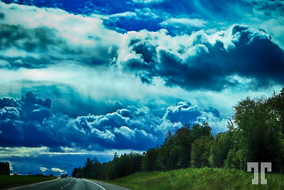"Driving under a stormy sky  * Are we more that just miniatures on this ""our"" planet?"
