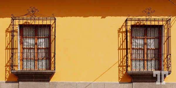 two-windows-on-yellow-wall-antigua-guatemala-2