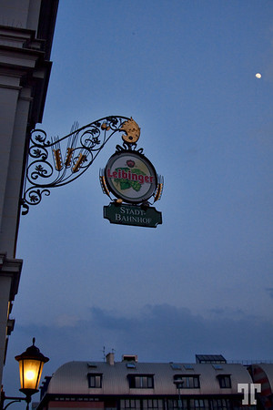 Leibinger beer sign at Stadt Bahnhof in Friedrichshafen, Germany at dusk