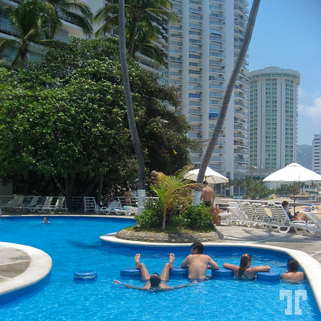 Enjoying the swimming pool at one of the Acapulco Mexico's hotels