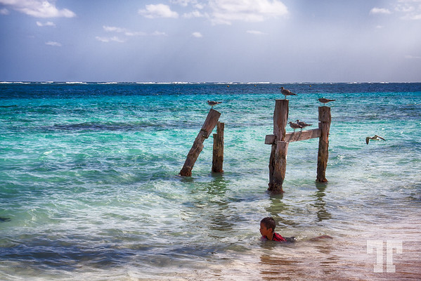 Mexican boy, swimming in the Golf of Mexico, Puerto Morelos